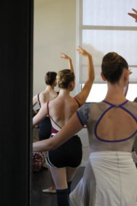 Company artists Bean, Georgie and myself begin each work day sharing a barre. Photo courtesy of Emily DeVito